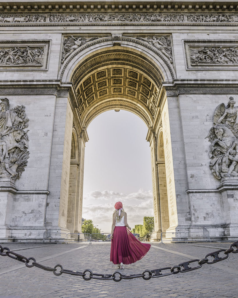 Woman at the feet of the Arc de Triomphe Paris