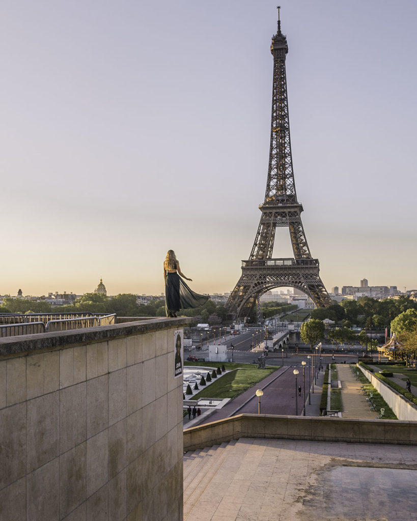 Woman standing on the edge at Trocadero with Eiffel Tower view