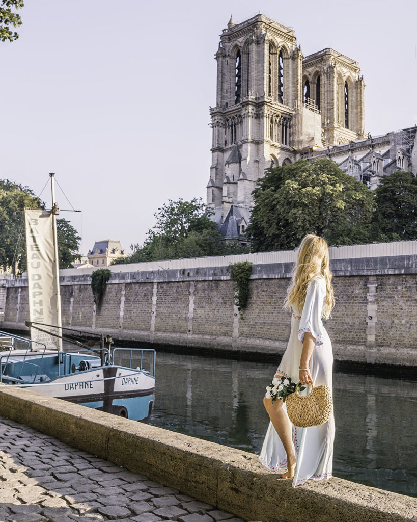 Woman standing on the Side of Notre Dame Cathedral in Paris
