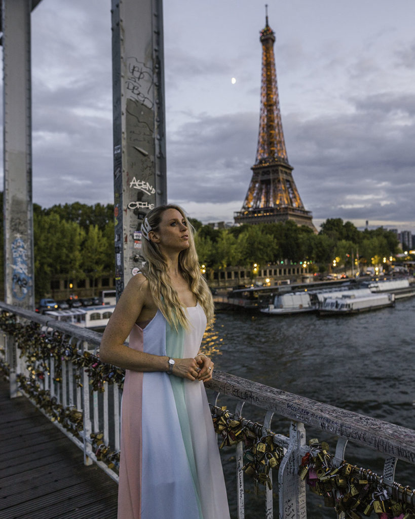 Woman watching the sunset at the Eiffel Tower from passerelle Debilly