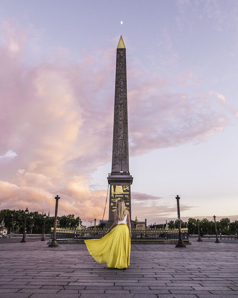 Woman standing in front of the Luxor Obelisk Place de la Concorde