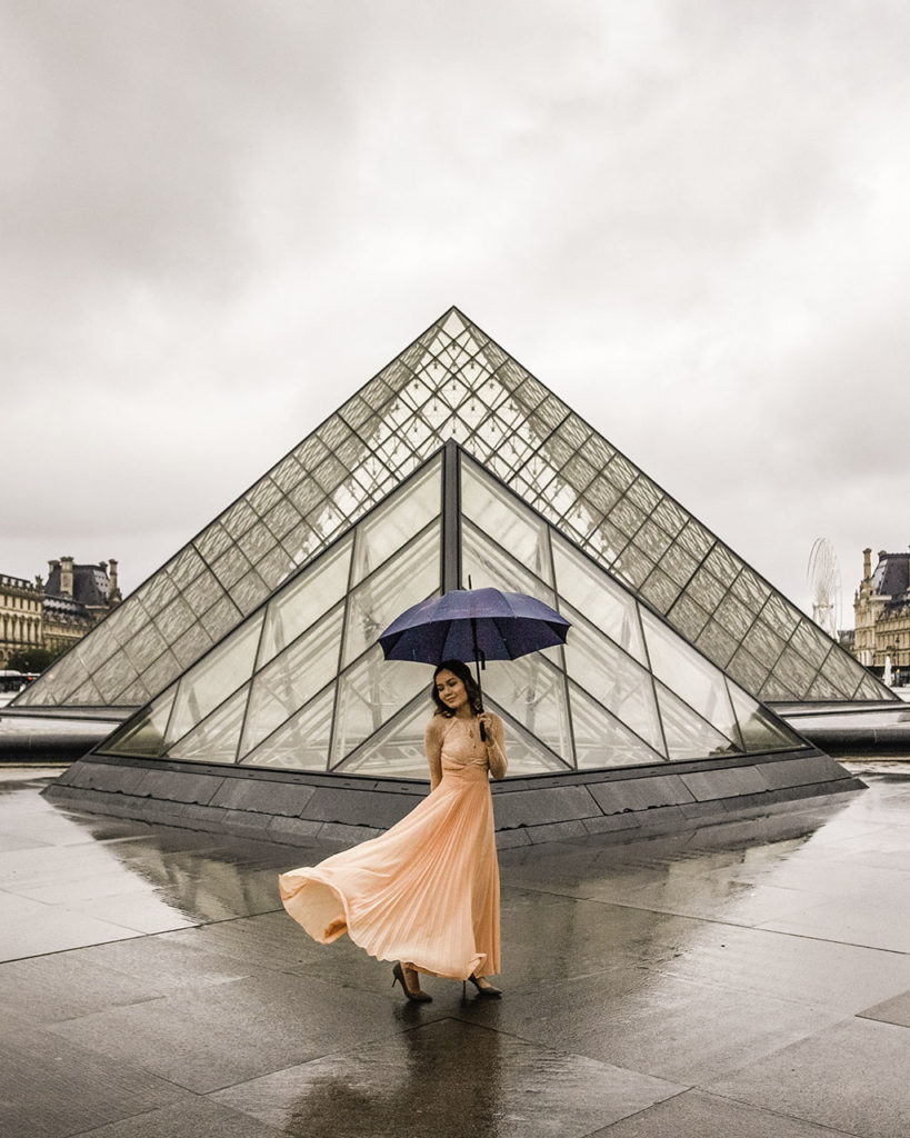 Photoshoot at the Louvre pyramid under the rain, Paris